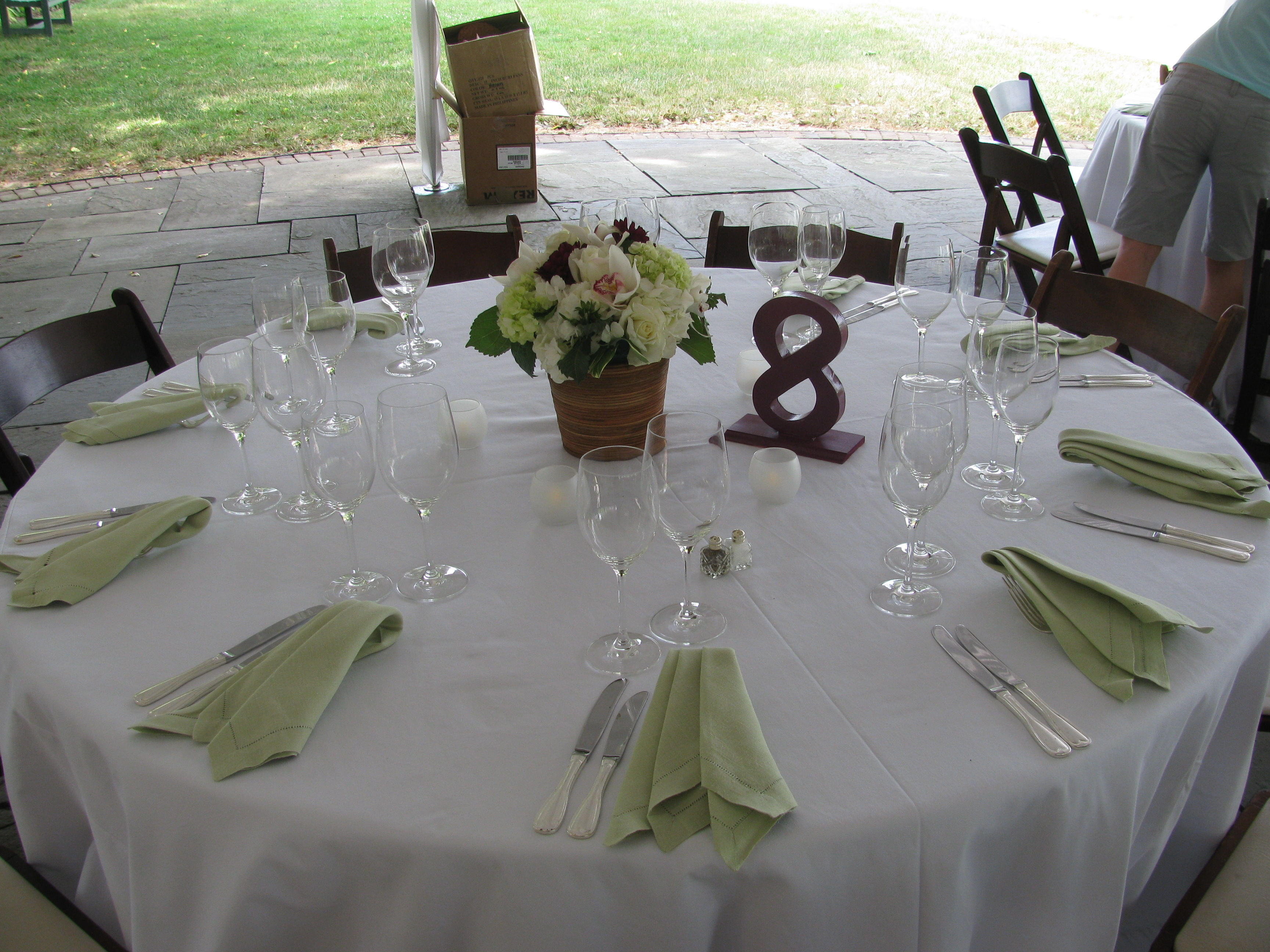 sneak peek river farm wedding napkins for wedding The green napkins and white linen really make the arrangement POP We also loved the table numbers which were actually made by the bride and groom